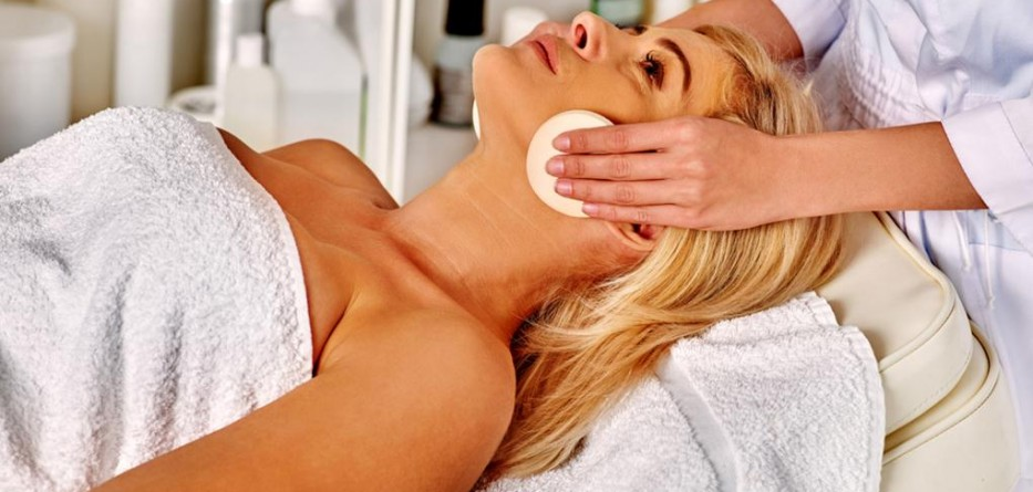 Woman middle-aged in spa salon with beautician