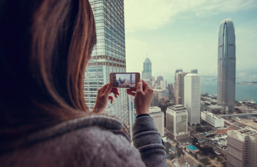 Taking photo of beautiful city with smartphone, cheap flights, cheap airlines, cheapest airlines, pictures, travel, city