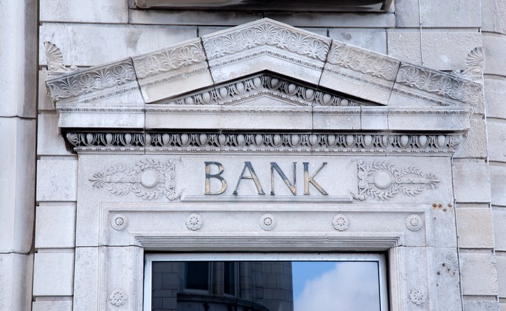 Bank Sign on White Building Facade