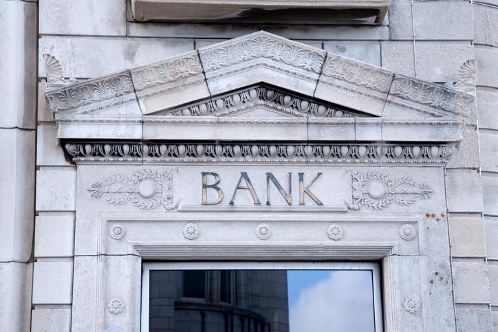 Bank Sign on White Building Facade