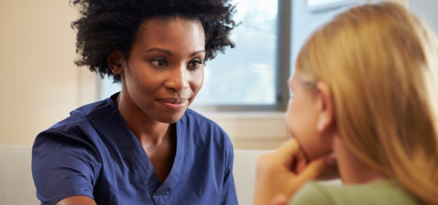 Nurse Treating Teenage Girl Suffering With Depression