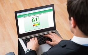 Businessperson Checking Online Credit Score Record On Laptop