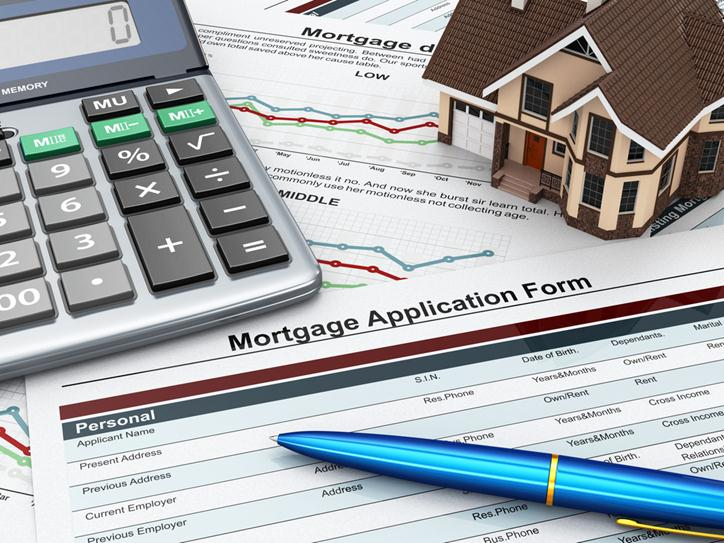 How-you-Can-Calculate-Mortgage-Costs-Featuredapplication form with a calculator and house. 3d