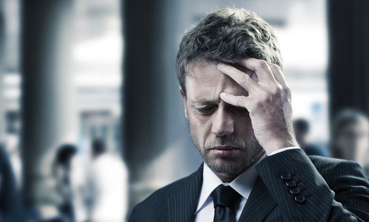 Portrait of a mature business man with headache