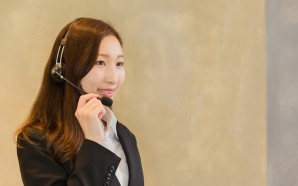 Portrait of young female customer service operator