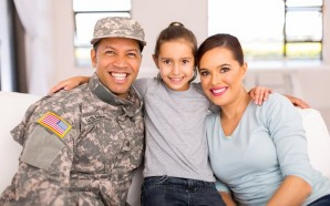 portrait of military family sitting on the couch at home
