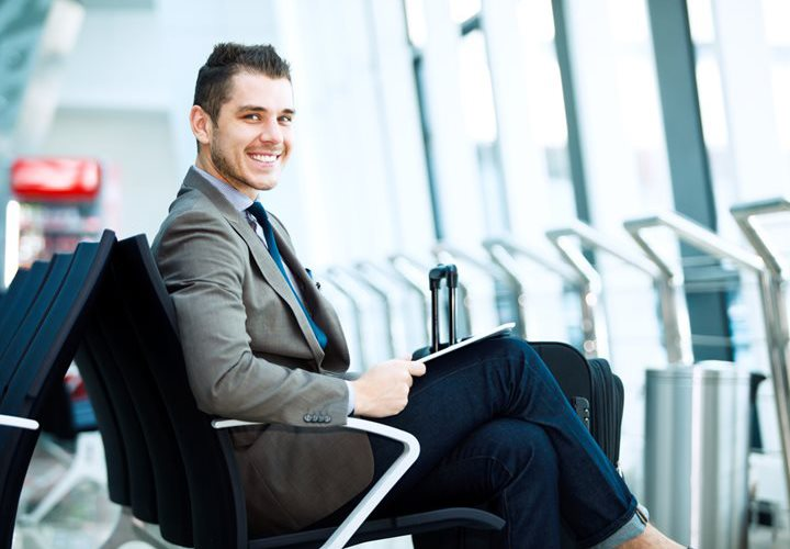 modern businessman using tablet computer at airport