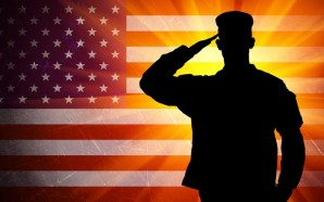 Proud saluting male army soldier on grungy american flag background
