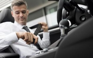 Businessman-in-his-car-fastening-the-seatbelt-safe-driving-concept