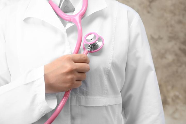 Doctor holding stethoscope, closeup
